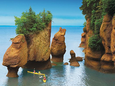 Kayakers enjoy the Hopewell Rocks at Hopewell Cape, New Brunswick (Bay of Fundy)